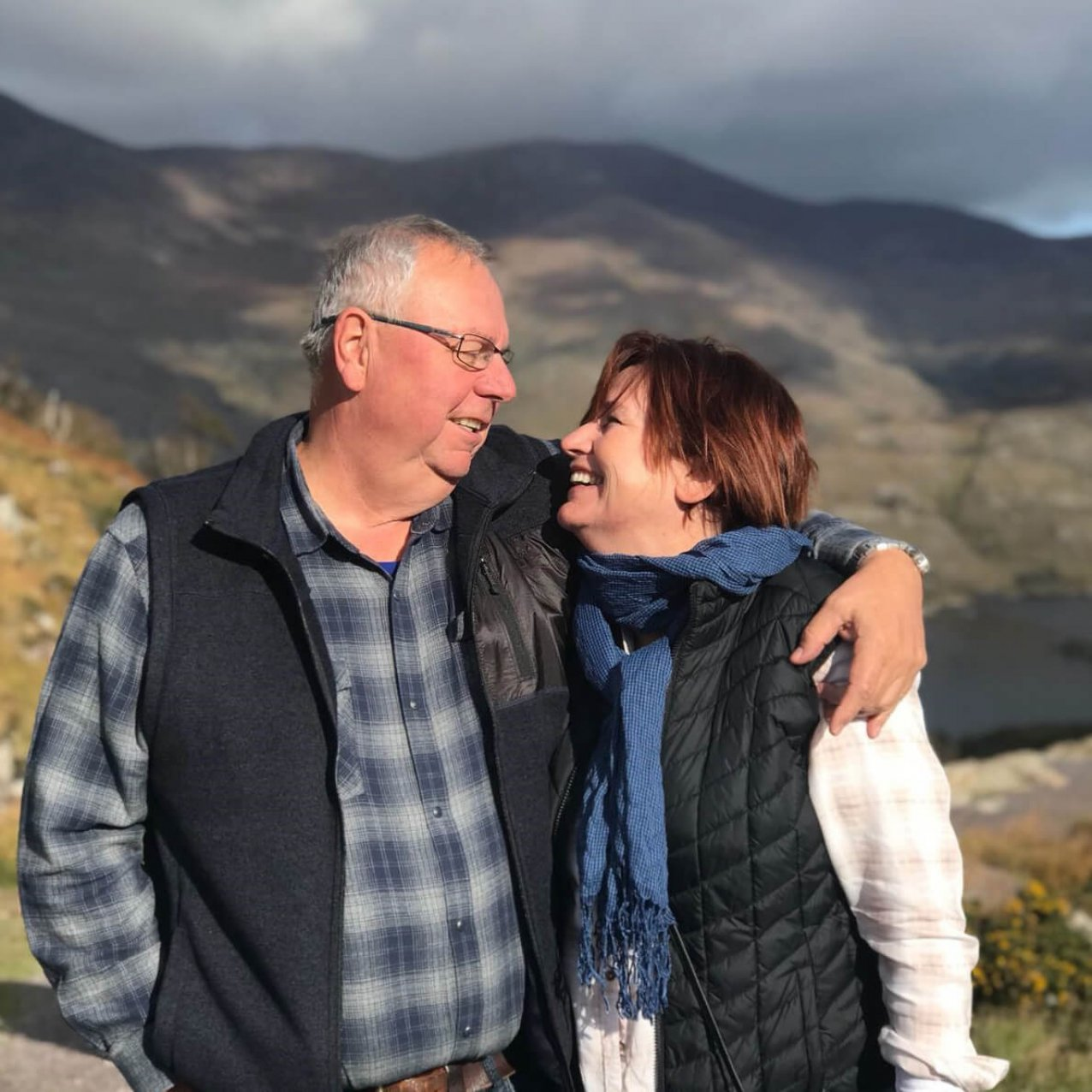Couple stare lovingly into each others eyes at scenic location in Ireland