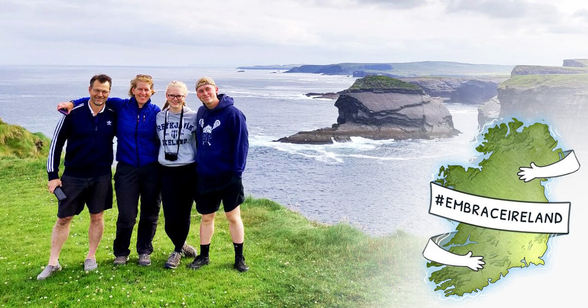 Family tour group in beautiful scenery in Ireland