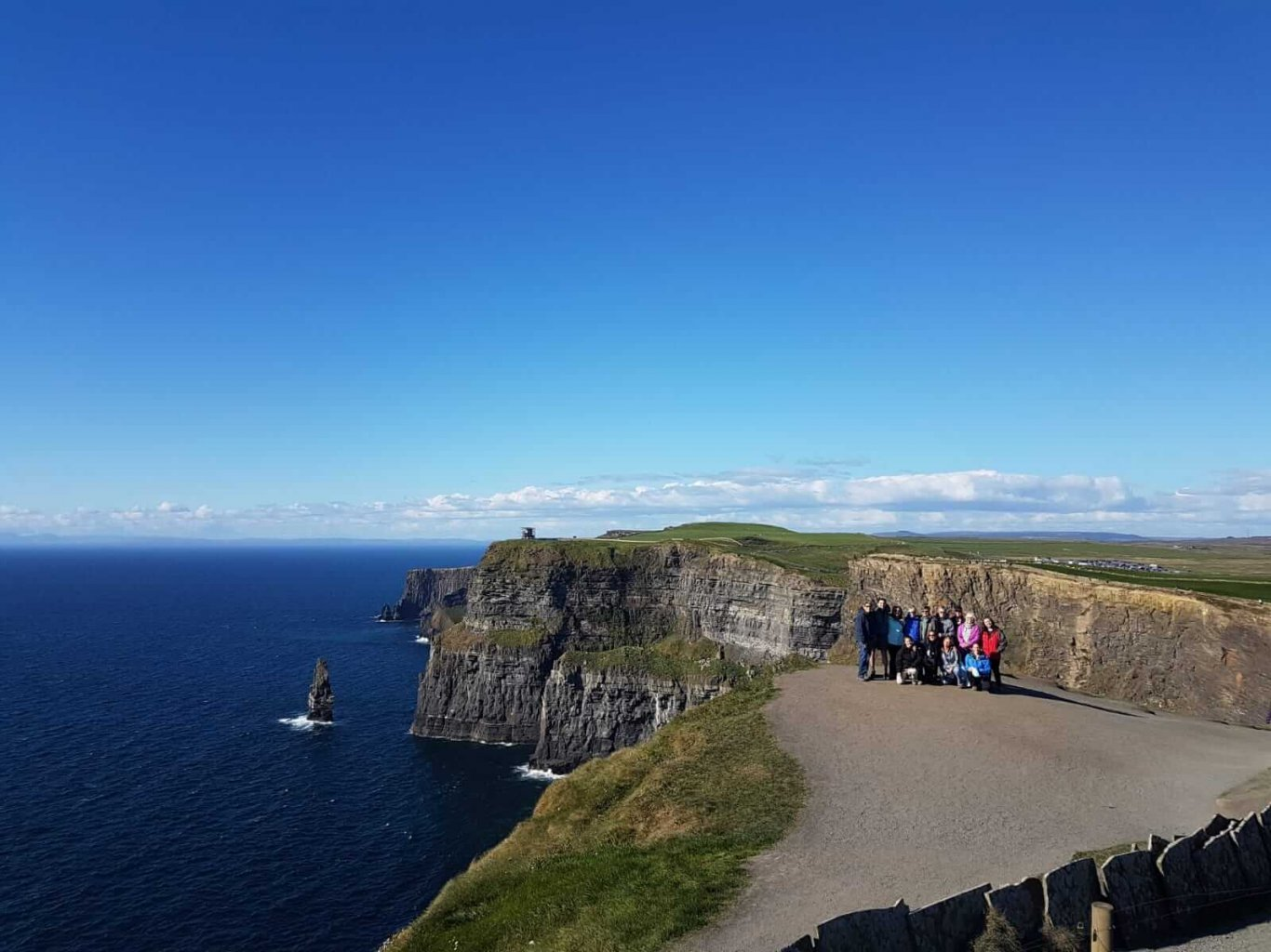 A Vagabond group posing for a picture at the cliffs of moher