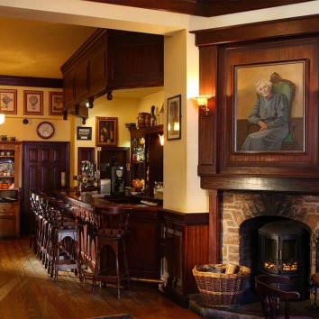 The traditional Irish interior of the Dingle Benners bar and Restaurant with a lighting fire