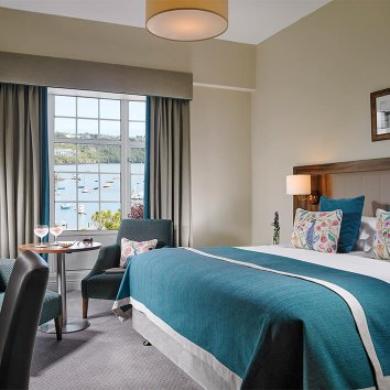 Interior design of a harbour view main bedroom