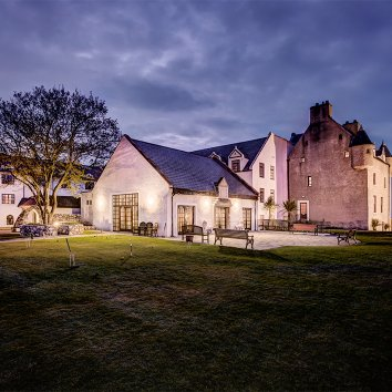 Exterior of Ballygally Castle Hotel at dusk