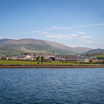 An amazing view of the Dingle Skellig Hotel and Dingle Bay with mountains in the background