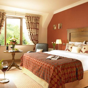 The interior design of a double room in the Glengarriff Park Hotel with wine displayed also in the room