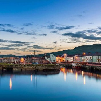 Picturesque evening light hits the harbour in Carnlough