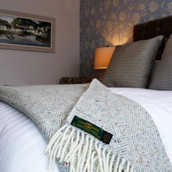 Bed and soft furnishings in a deluxe room at the Nesbitt Arms Hotel in Ardara, Donegal, Ireland