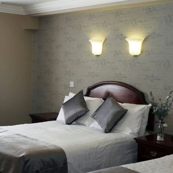Interior design of a main bedroom in the Nesbitt Arms
