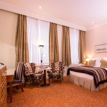 The interior design of a main bedroom in the Slieve Donard Resort