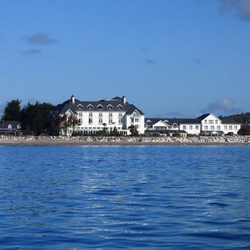 The exterior of the Garryvoe hotel and a view of Ballycotton Bay