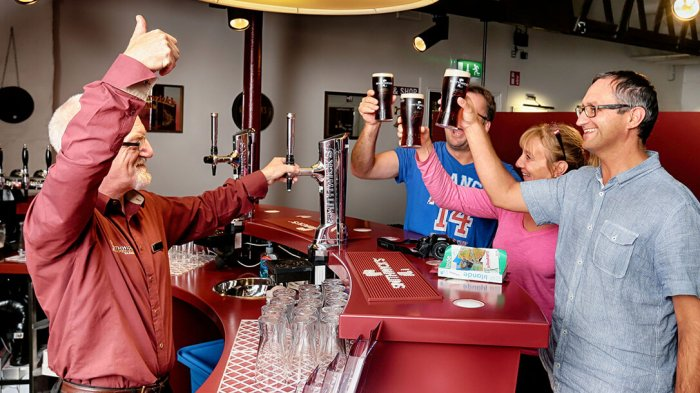 Smithwicks Brewery tour group with beer in Ireland