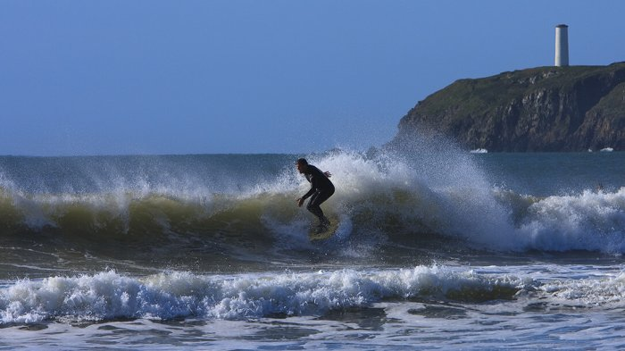 Surfer on a wave in Waterford in Ireland