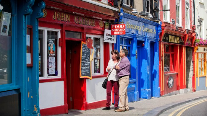 Couple exploring colourful shops in Kilkenny, Ireland