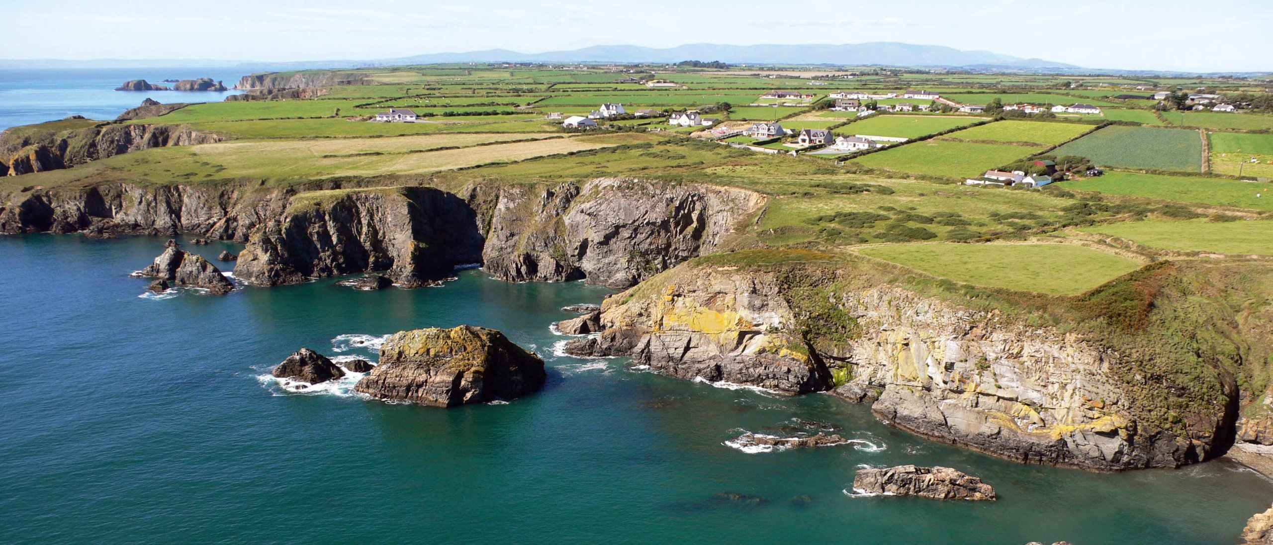 Copper Coast in Waterford with green patchwork fields and cliffs
