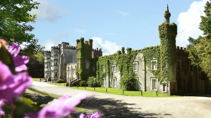 Exterior view of Ballyseede Castle hotel in Ireland showing foliage and greenery