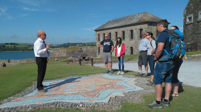 A tour guide leads a Driftwood tour group around Charles Fort in Kinsale, Ireland