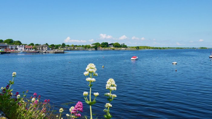 The picturesque town of Kinvara looking out to sea with boats in the harbour