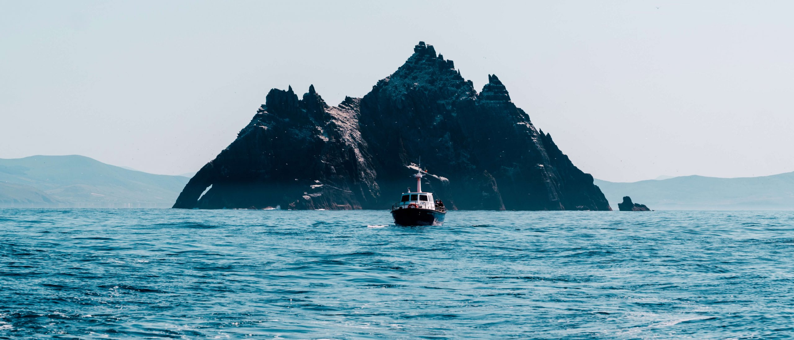 A boat in front of Little Skellig island off the coast of Ireland