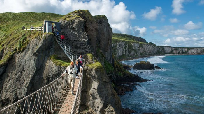 Guests crossing the Carrick-a-Rede rope bridge suspended over the Atlantic