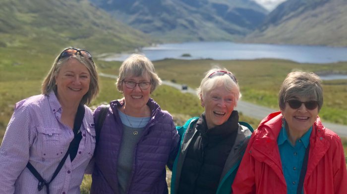 Smiling female tour group in Doolough Valley, Ireland