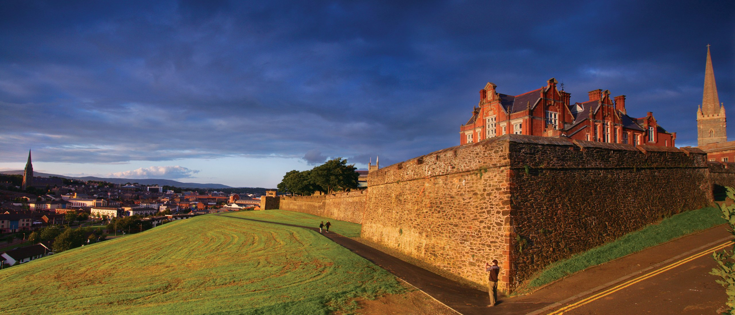 Sunlight catches the 17th century walls of Derry, Ireland's only walled city