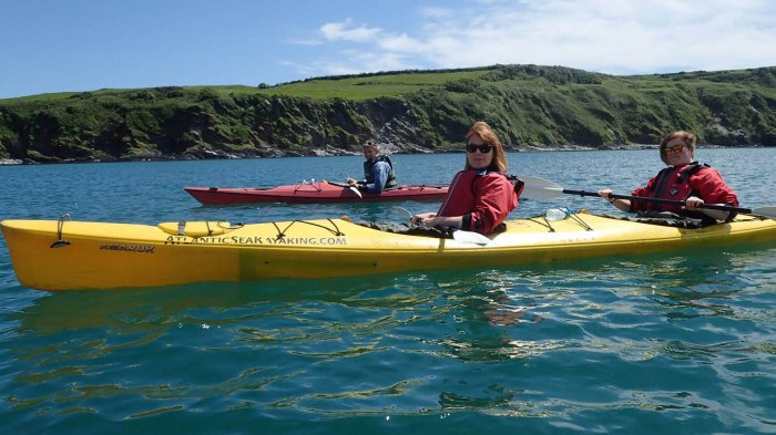 Kayakers in sea kayak in Ireland