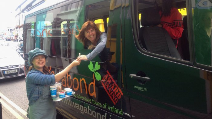 Murphy's Ice Cream staff giving samples to Vagabond guest through tour vehicle window in Dingle, Ireland
