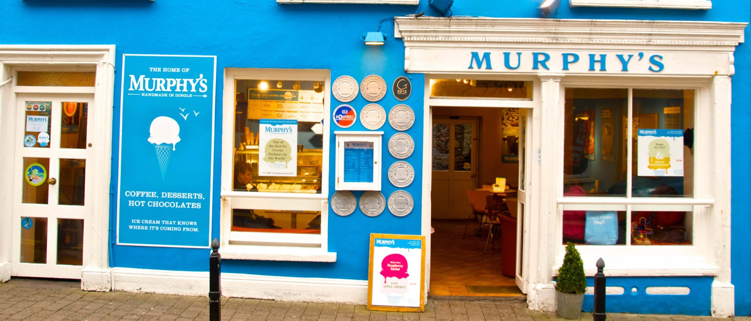 Brightly painted blue exterior of Murphy's ice cream parlour in Dingle, Ireland