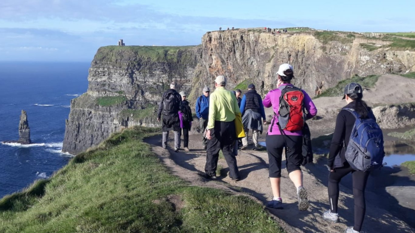Vagabond Tour Group hiking the Cliffs of Moher in Ireland
