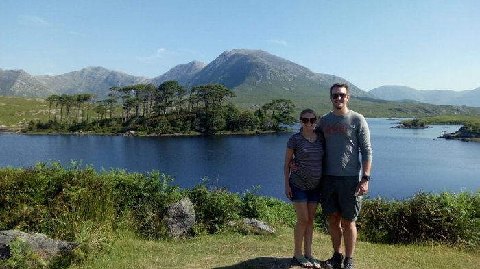 A couple posing in front of the twelve bens in Connemara