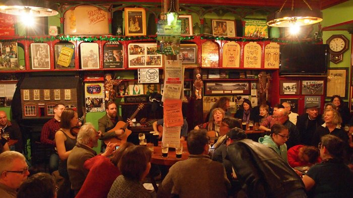 A group of musicians taking part in an Irish  trad music night in O'Flaherty's pub in Dingle