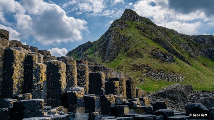 Basalt columns of the Giant's Causeway wtih a mountain in the background