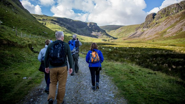 Group hiking in Annascaul valley on the Dingle peninsual