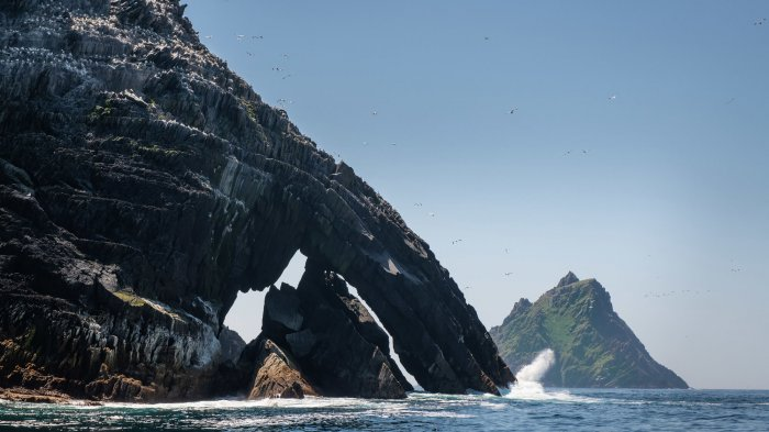 Sea arch on Little Skellig with Skellig Michael in the background