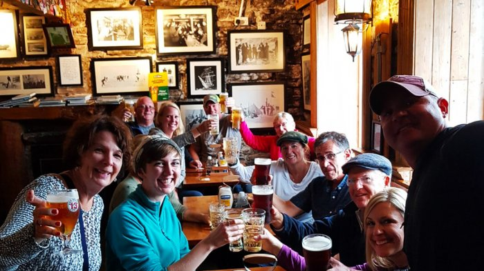A group of Vagabond guests enjoying their pints of beer in the South Pole Inn in Annascaul