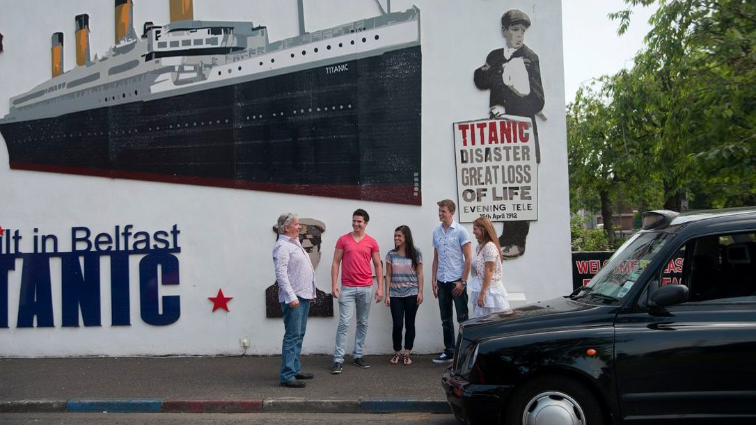 Black Cab tour in Belfast in front of  Titanic mural
