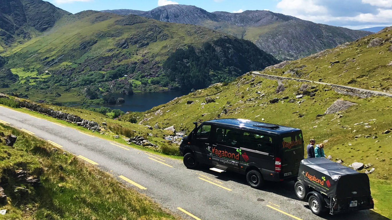 A VagaTron tour vehicle parked at a scenic location on the Healy Pass, Ireland