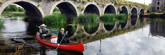 Couple canoeing on the River Barrow in Ireland