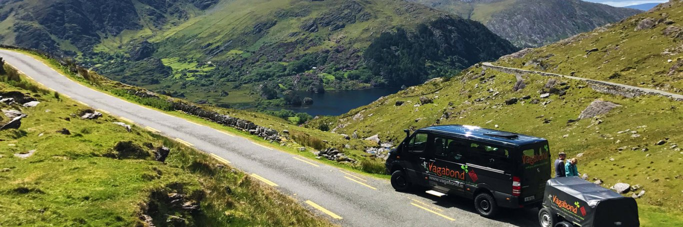 A VagaTron tour vehicle stopped at a scenic location on the Healy Pass in Ireland