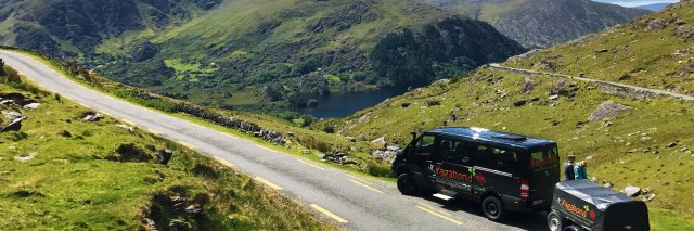 A VagaTron 4x4 tour vehicle parked at a scenic location on the Healy Pass in Ireland