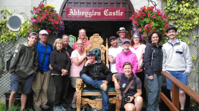 Vagabond Group posing in front of Abbeyglen Castle Hotel in Ireland with a throne
