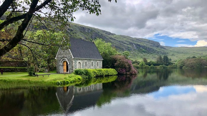 The Gougane Barra church surrounded by a lake and forest
