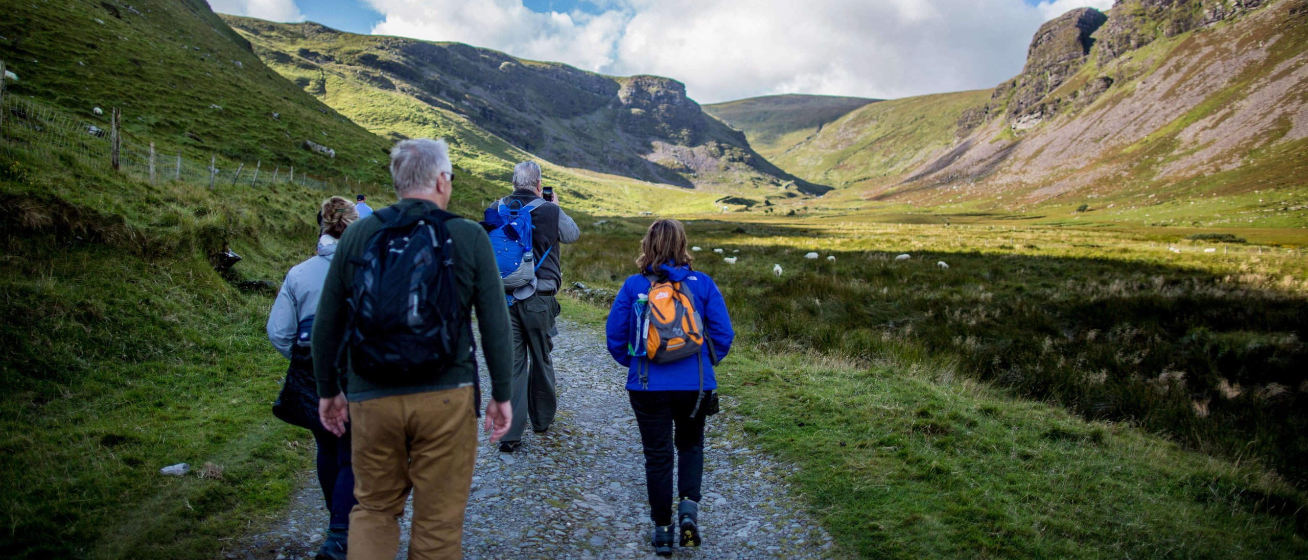 Group hiking in Annascaul valley, Dingle peninsula