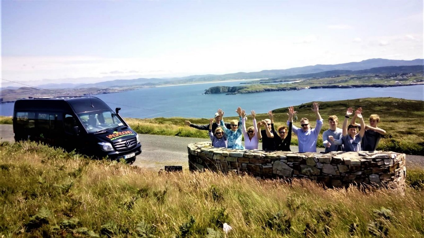 Happy Vagabond tour group enjoying a private tour of Ireland