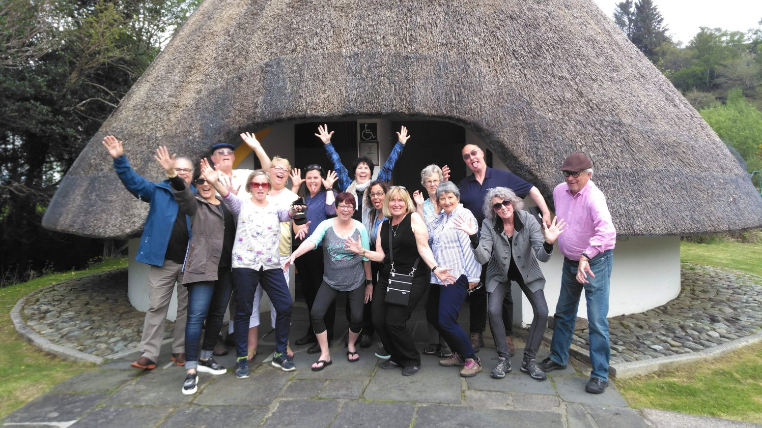 A group of excited Vagabond guests at Ireland's finest toilets in Gougane Barra Forest Park