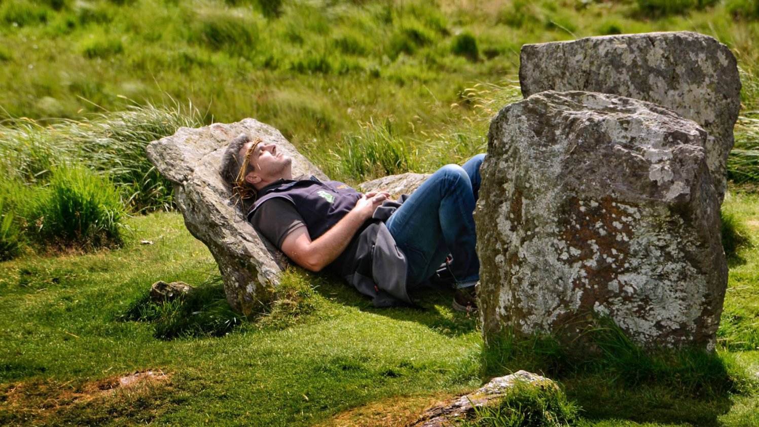 VagaGuide Tim relaxing on an ancient stone circle in Ireland