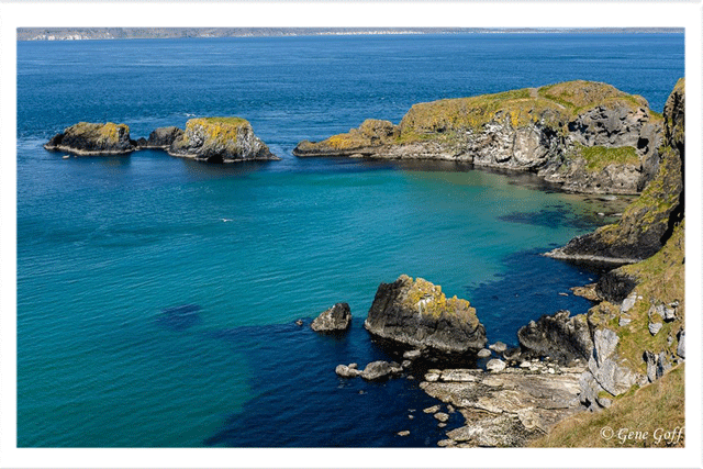 Carrick-a-rede bridge, with Raitlin Island in the near distance and Scotland in the in the far distance. Thanks Gene Goff for the photo.