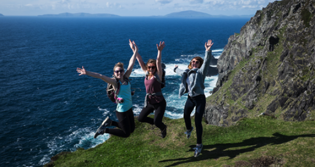 A trio of Vagabond guests jumping on the Irish coastline