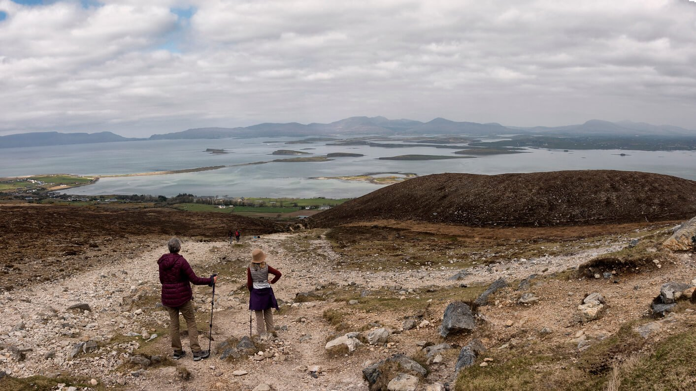 Two climbers enjoy the view from Croagh Patrick over Clew Bay