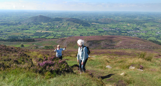 12 Day Ginat Irish Adevnture tour guests; Catherine and Monika climb Slieve Gullion