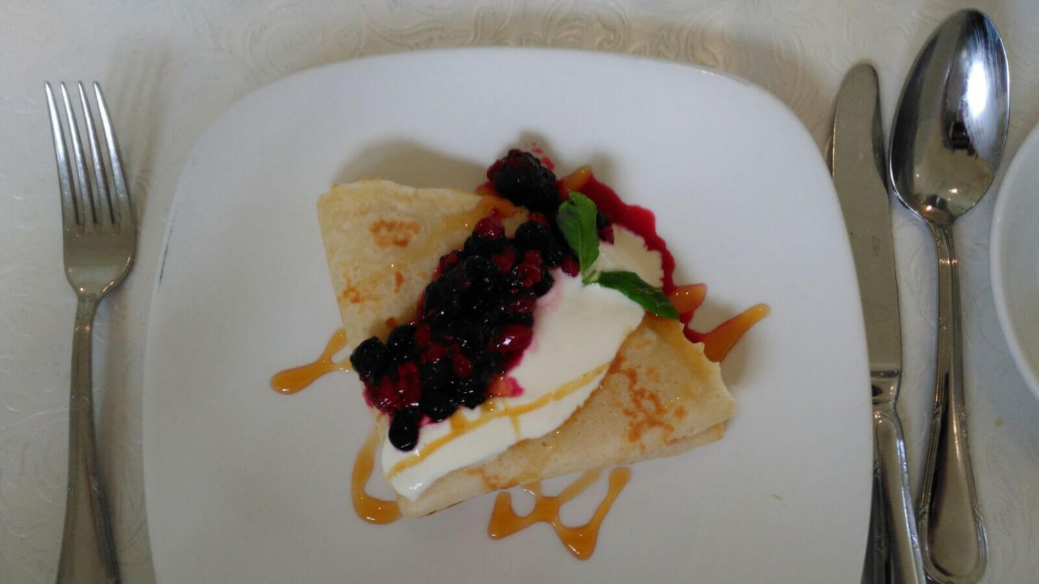 Pancakes served with fresh berries at Beech Hill Country House in Derry